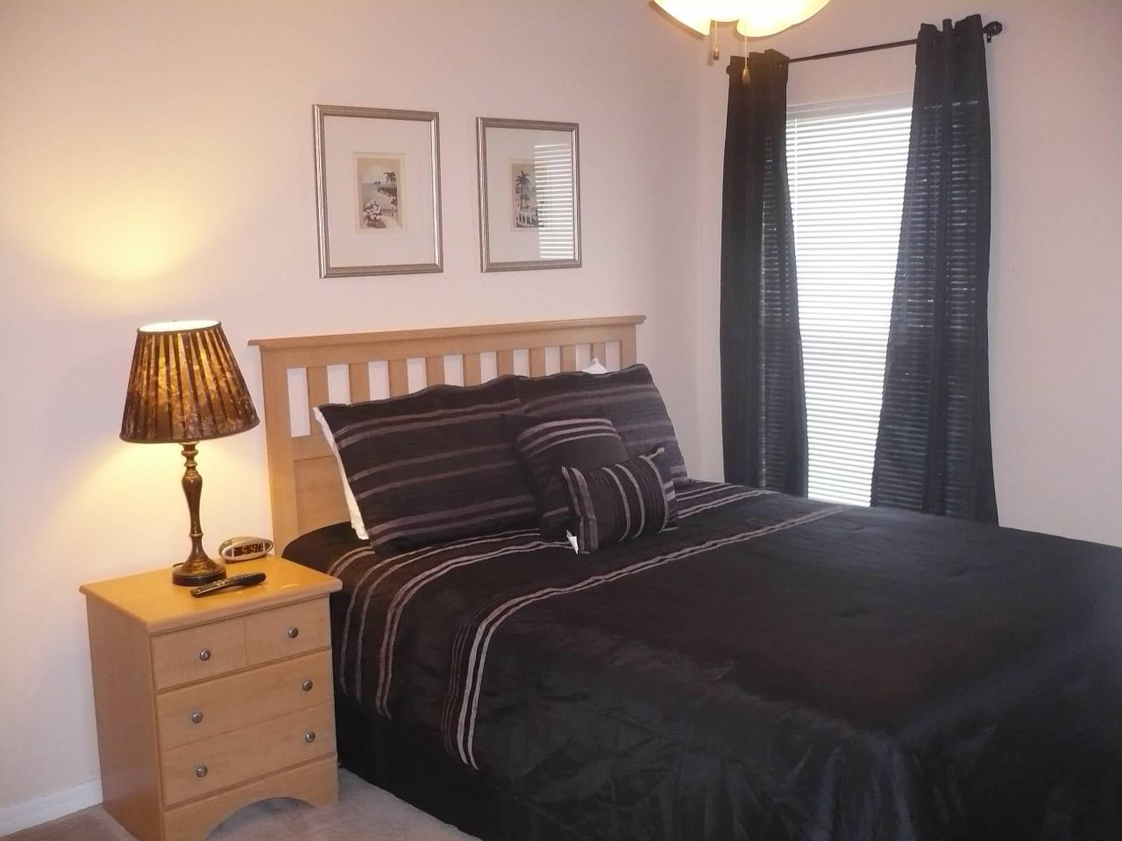 Bedroom-2 Queen bed, dresser, TV